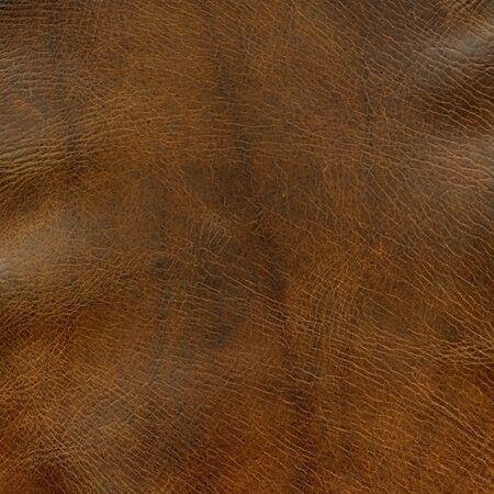 いくつかのしわ - 古い馬サドルの上で不良茶色の革の背景