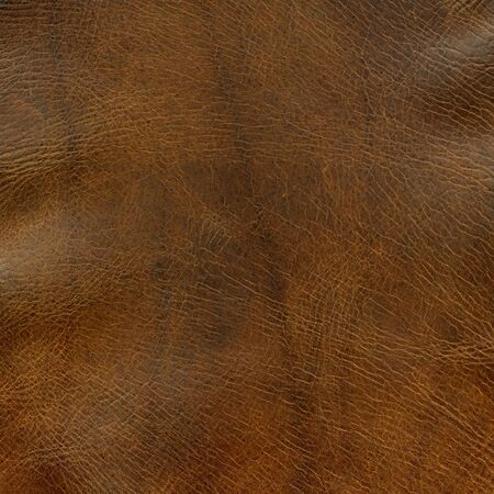 distressed brown leather background with some wrinkles - a top of old horse saddle