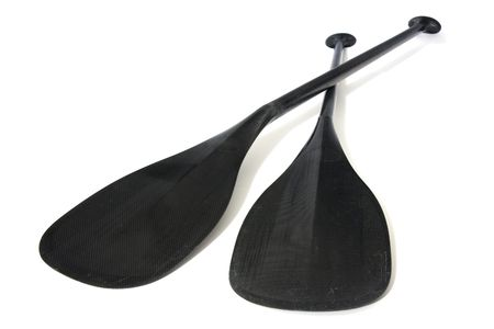 two lightweight carbon fiber paddles for canoe racing, low level angle with focus on blades scratched in river use Stock Photo - 5276957