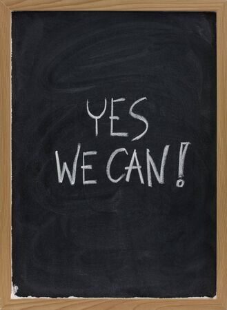 Yes we can - motivational slogan handwritten with white chalk on blackboard with eraser smudges Stock Photo - 5356756