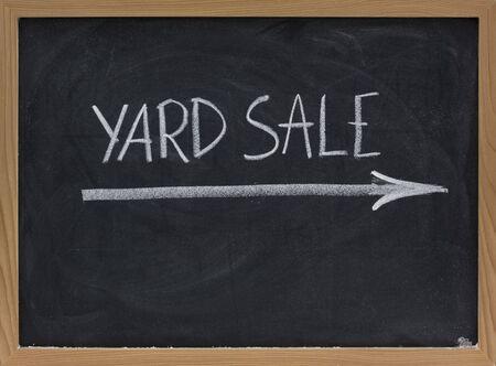 yard sale text handwritten with white chalk on blackboard Stock Photo - 5433311