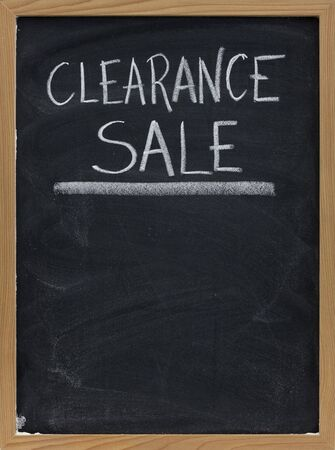 clearance sale text handwritten with white chalk on blackboard with copy space below Stock Photo - 5465894