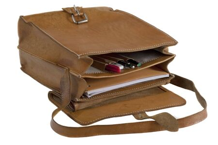 opened bag: old leather school bag with scratches and stains - opened showing pens and notebook, isolated on white