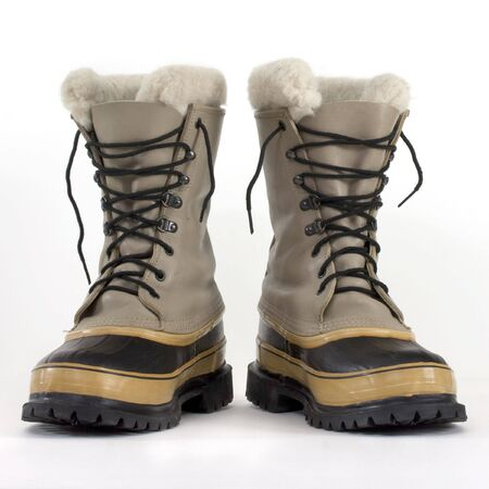 a pair of heavy snow boots on white background, low angle perspective Stock Photo - 5514317
