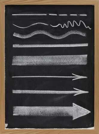 thickness: design elements, lines and arrows with different thickness, white chalk sketch on blackboard  Stock Photo