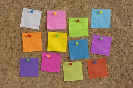billboard posting: colorful blank notes pinned on cork bulletin board Stock Photo