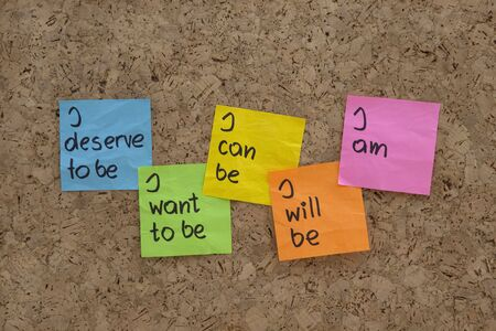 a scripts for self-help, personal change and fulfillment presented with color sticky notes on  cork bulletin board photo