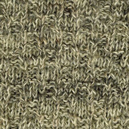 fabric texture: close-up of white, gray, brown handmade knitted wool sweater texture