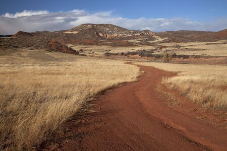 windy road in Red Mountain Open Space in northern Colorado (Larimer County), fall scenery with dry grass moved by wind Stock Photo - 5720214