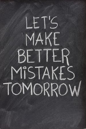 lets make better mistakes tomorrow text handwritten with white chalk on blackboard