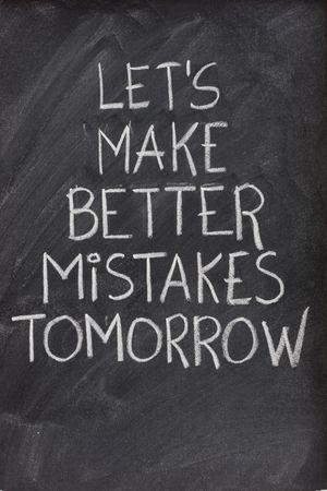 tomorrow: lets make better mistakes tomorrow text handwritten with white chalk on blackboard