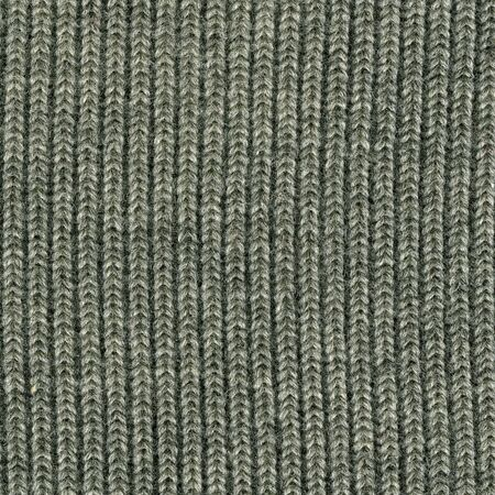 close-up of gray knitted wool sweater texture, vertical thread patterns photo