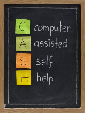 assisted: CASH - computer assisted self help - acronym for modern age, presented on blackboard with white chalk handwriting and color sticky notes Stock Photo