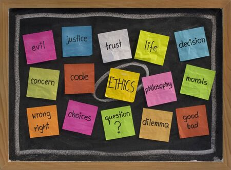 ethical: cloud of words related to ethics, color sticky notes on blackboard Stock Photo