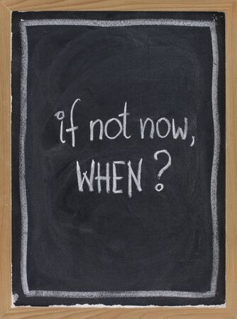 call for action or decision - white chalk handwriting on blackboard with eraser texture photo