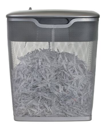 light duty: light duty paper shredder with metal wire basket filled with document shreddings, isolated on white