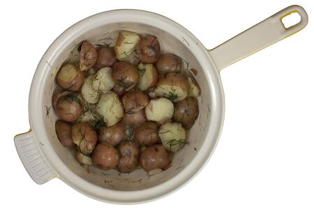a pot of freshly cooked young red potatoes prepared with salt, dill and melted butter, isolated on white, clipping path Stock Photo - 5872274