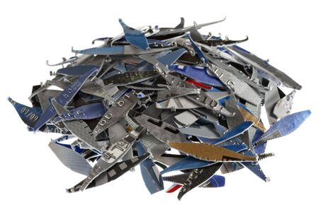 a pile of old expired credit card shredded, isolated on white - protection against identity theft concept photo
