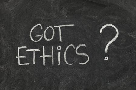 Got ethics? Are you ethical question handwritten with white chalk on blackboard with eraser smudges