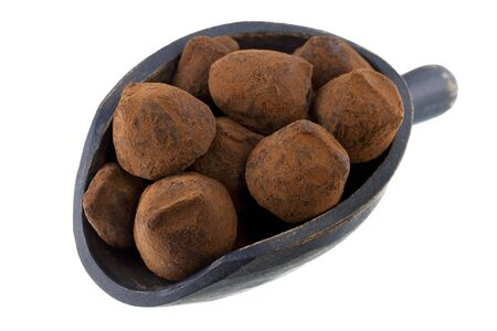chocolate truffles on a rustic wooden scoop isolated on white Stock Photo - 6134644