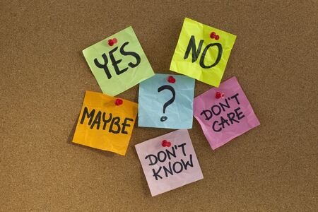 yes, no, maybe, ...  undecided voter concept, colorful sticky notes on cork bulletin board Stock Photo - 6196982