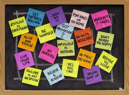 motivational slogans and phrases - colorful reminder notes on blackboard Stock Photo - 6255255