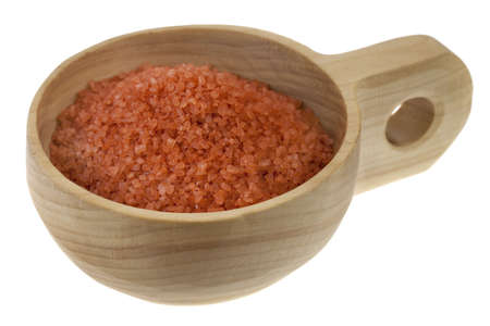 Crystals of traditional Hawaiian alaea sea salt containing red clay and rich in minerals on a primitive rustic wooden bowl (scoop); isolated on white Banco de Imagens - 6283053