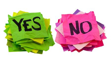 yes or no: yes and no handwriting - two stacks of colorful crumpled reminder notes isolated on white Stock Photo