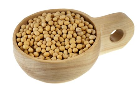 yellow soy beans on a rustic, wooden, scoop or bowl, isolated on white background Stock Photo - 6423834