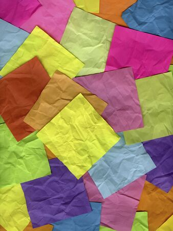 blank yellow sticky note on top of background of crumpled colorful notes Stock Photo - 6514219