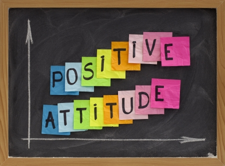 positive attitude concept - colorful sticky notes, handwriting and white chalk drawing on blackboard 版權商用圖片