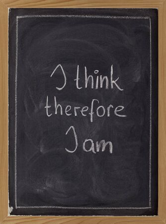 I think, therefore I am - philosophical statement used by RenŽ Descartes; white chalk handwriting on blackboard Stock Photo - 6514233