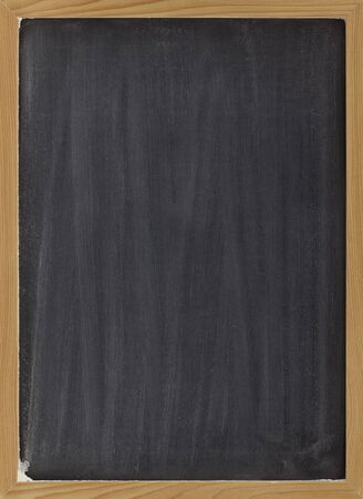 smudges: blank blackboard with vertical white chalk smudges, ready to be used as a menu or other sign Stock Photo