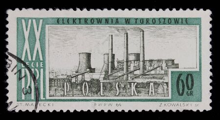 POLAND 1964 - vintage canceled post stamp with drawing of coal power plant in Turoszow, commemorating 20th anniversary of Polish People Republic, black background Stock Photo - 6564761