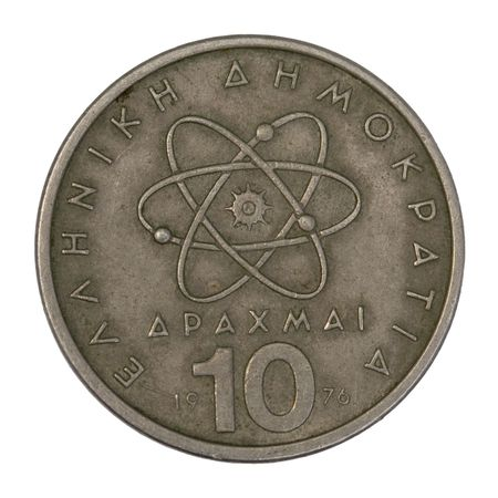 scientific model or symbol of atom schematically represented on old circulated 10 drachma Greek coin from 1976, isolated on white  Imagens
