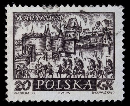 POLAND, circa 1960 - medieval town of Warsaw, Polish capitol,  with hussar winged cavalry on a vintage, canceled post stamp, dark brown engraving on white