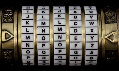 word money set as a password in combination puzzle box (cryptex) with rings of letters Stok Fotoğraf