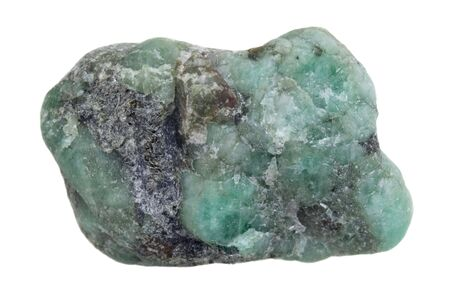 beryl: raw emerald gemstone (mineral beryl)  with inclusions mined in Brazil isolated on white