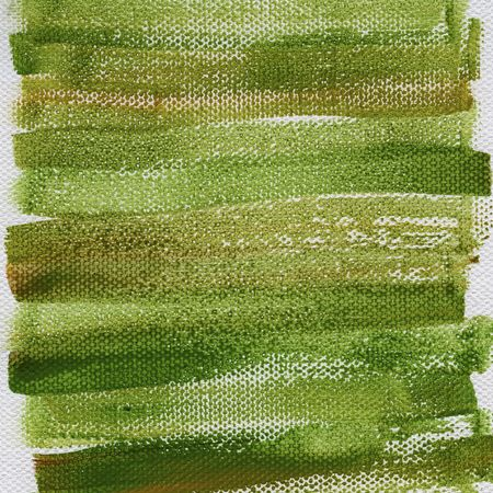 green and brown grunge watercolor abstract on artist canvas with a coarse texture, self made by photographer