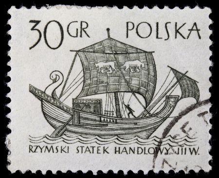 merchant: POLAND, circa 1960 - ancient Roman merchant sail ship on a vintage canceled post stamp, black drawing on white