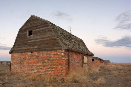 abandoned brick barn and farm buildings in eastern Colorado prairie at dusk Stock Photo - 6659798