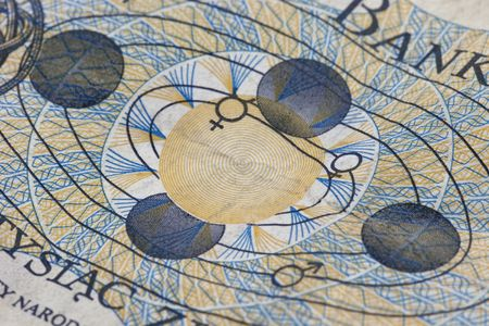 engraving detail of solar system with Earth in four postions on old crumpled 1000 zloty banknote from Poland commemorating Copernicus heliocentric concept Banco de Imagens