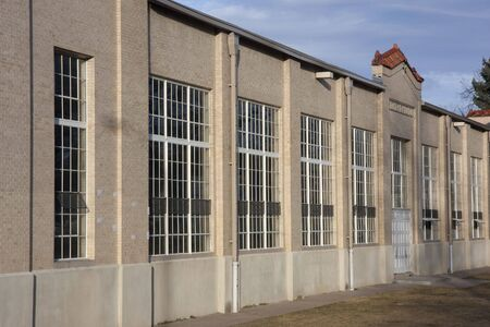indoor sport: wall with big windows - exterior of old field house with indoor sport arena at university campus  Stock Photo