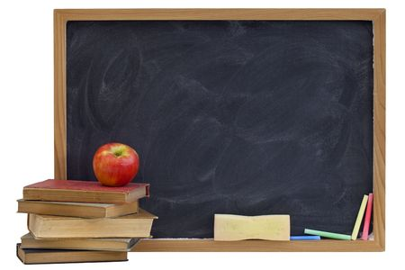 education concept - blank blackboard with white chalk texture, red apple on a stack of old textbooks, sponge eraser, color chalk