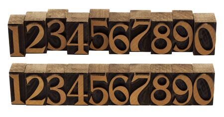 arabic numerals: ten arabic numerals 0-9 in vintage wood letterpress blocks stained by black ink,, flipped horizontally, two compositions, isolated on white