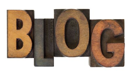 word blog (web log)  in vintage wooden letterpress type, stained by ink, isolated on white photo