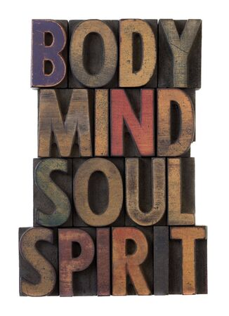 mind body soul: body, mind, soul, spirit in vintage wooden letterpress types, stained by ink in different colors, isolated on white