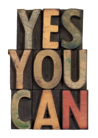 slogan: Yes you can - motivational slogan in vintage letterpress wooden type, stained by ink, isolated on white