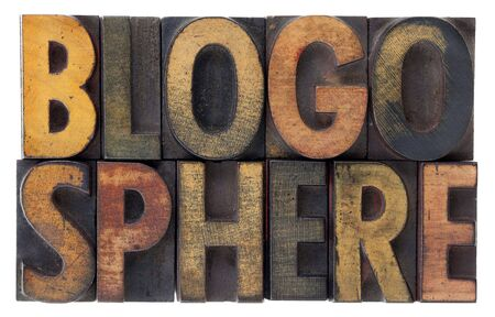 blogosphere: word blogosphere (global blog community) in vintage wood letterpress types, stained by ink, isolated on white