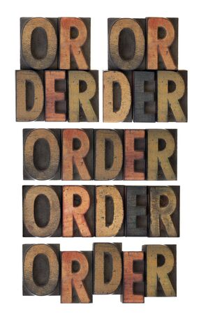 several layout version of word order, vintage letterpress wood type scratched and stained by ink, isolated on white Stock Photo - 6790290